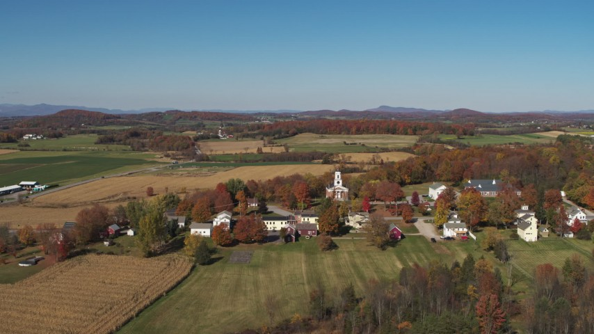 5.7K stock footage aerial video approach a church in the small town of Orwell, Vermont, farm fields in background Aerial Stock Footage | DX0002_217_003
