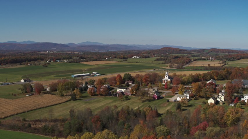 5.7K stock footage aerial video reverse view of a church and farm fields in the small town of Orwell, Vermont Aerial Stock Footage | DX0002_217_004