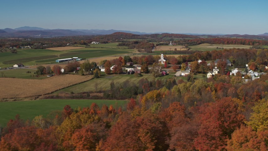 5.7K stock footage aerial video orbit farm fields and the small town of Orwell, Vermont Aerial Stock Footage | DX0002_217_005