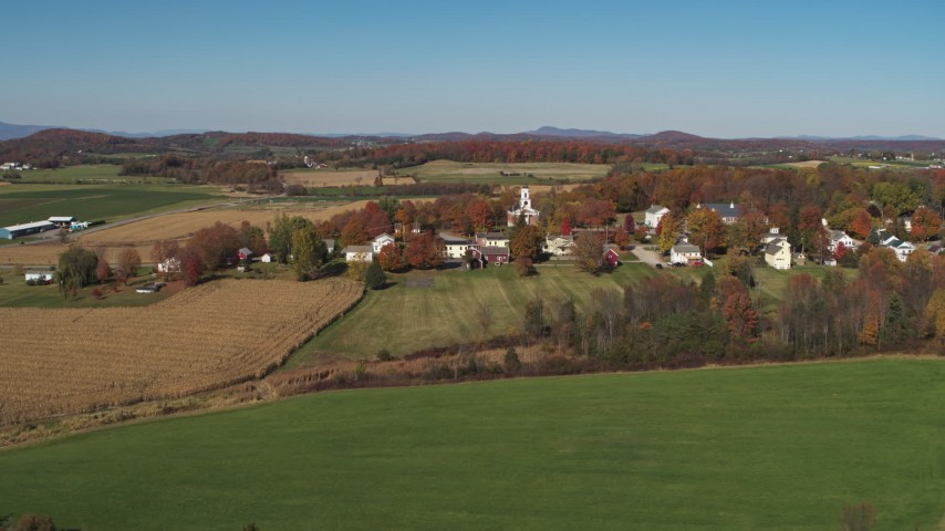 5.7K stock footage aerial video approach and orbit farm fields around the small town of Orwell, Vermont Aerial Stock Footage | DX0002_217_006