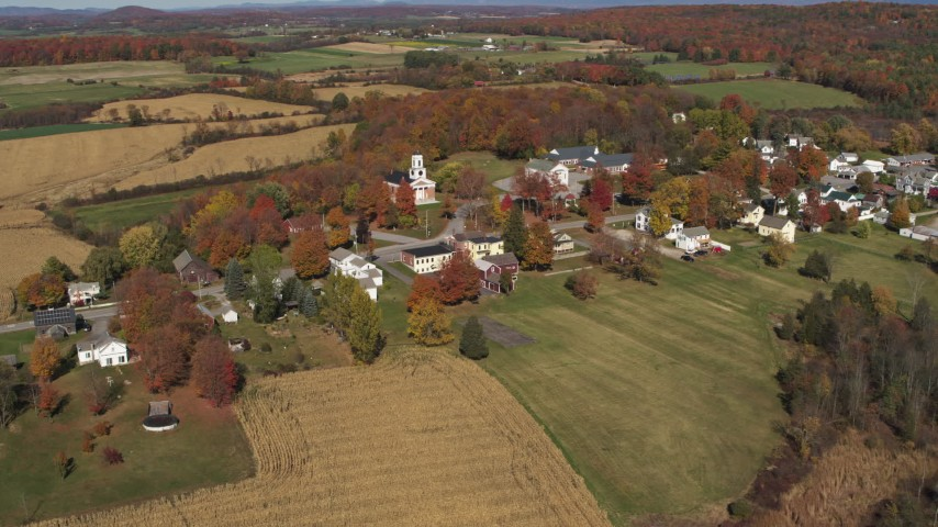5.7K stock footage aerial video orbit the small town of Orwell, Vermont surrounded by farm fields Aerial Stock Footage | DX0002_217_007
