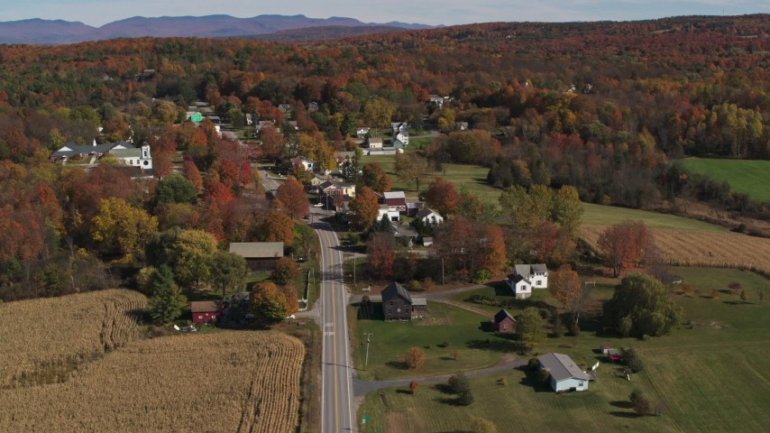 5.7K stock footage aerial video of orbiting Main Street in a small town beside a forest in autumn, Orwell, Vermont Aerial Stock Footage | DX0002_217_009