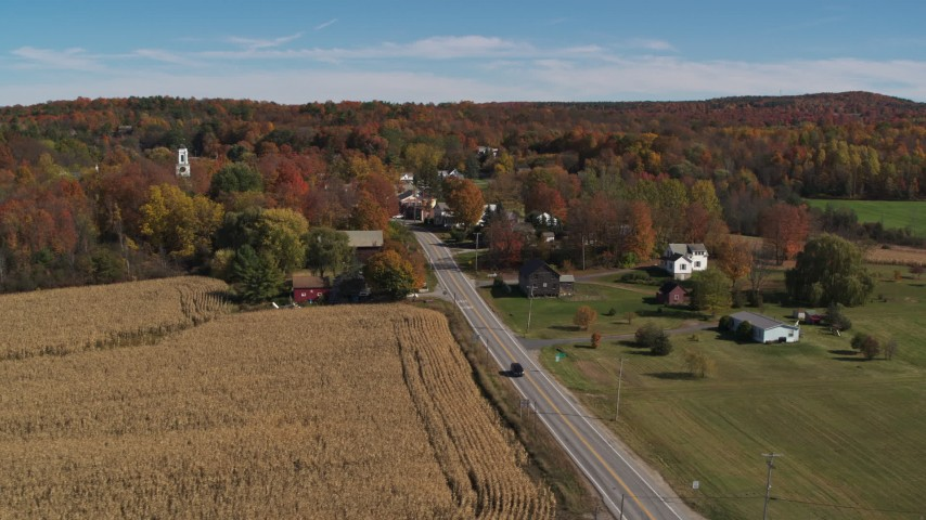 5.7K stock footage aerial video flyby a country road beside a small town in autumn, Orwell, Vermont Aerial Stock Footage | DX0002_217_012