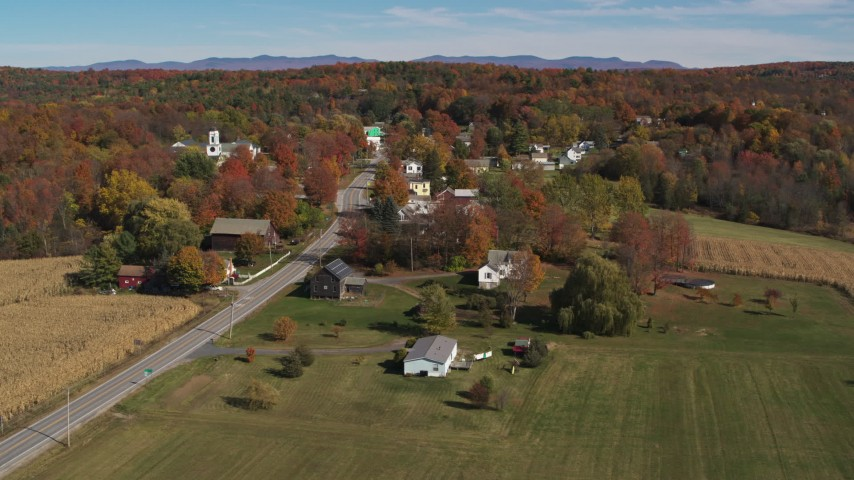 5.7K stock footage aerial video circling Main Street in a small town in autumn, Orwell, Vermont Aerial Stock Footage | DX0002_217_013