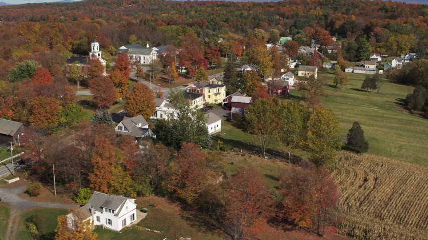 5.7K stock footage aerial video approach and orbit a small town in autumn, Orwell, Vermont Aerial Stock Footage | DX0002_217_014