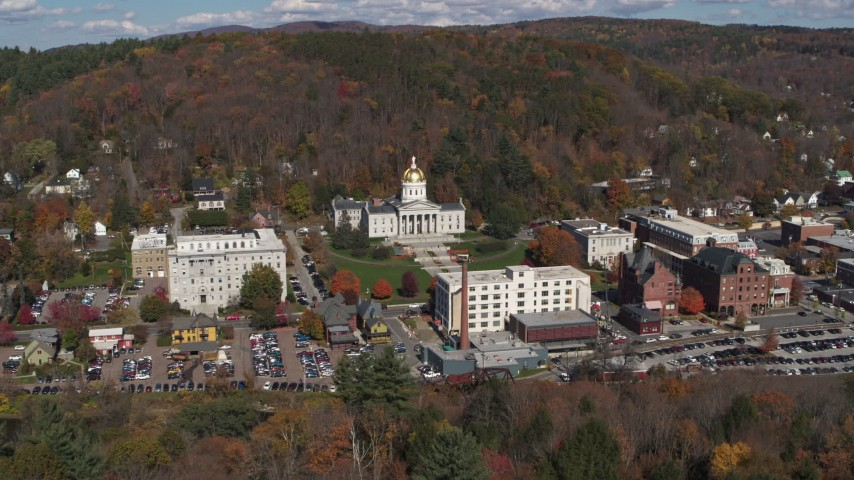 5.7K stock footage aerial video of a reverse view of the state capitol building and downtown in Montpelier, Vermont Aerial Stock Footage | DX0002_218_003