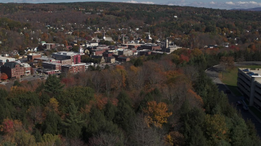5.7K stock footage aerial video of the downtown area of the city seen from a parking garage on a hill, Montpelier, Vermont Aerial Stock Footage | DX0002_218_009