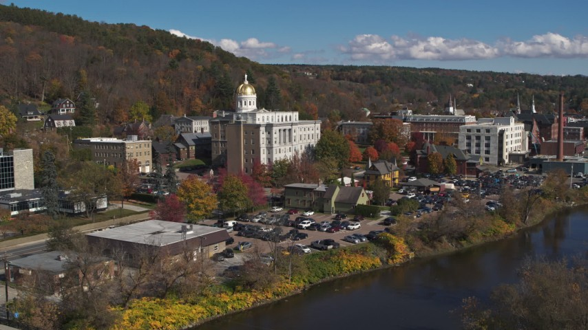 5.7K stock footage aerial video of the state capitol building seen while descending by the river, Montpelier, Vermont Aerial Stock Footage | DX0002_218_011