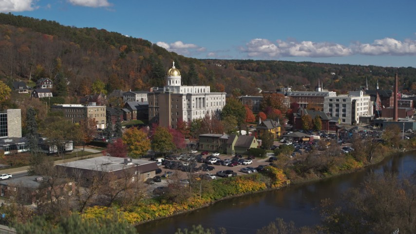 5.7K stock footage aerial video ascend from tree to reveal the state capitol building across the river, Montpelier, Vermont Aerial Stock Footage | DX0002_218_012