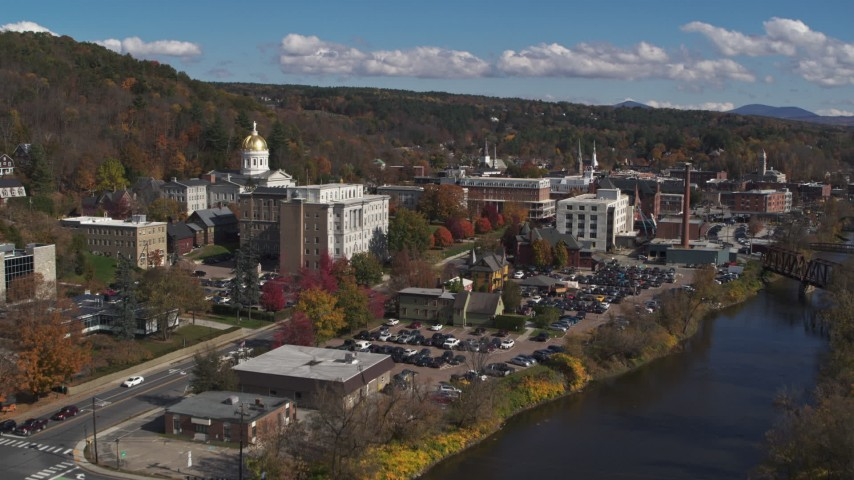 5.7K stock footage aerial video fly over river toward government office and state capitol building, Montpelier, Vermont Aerial Stock Footage | DX0002_218_016