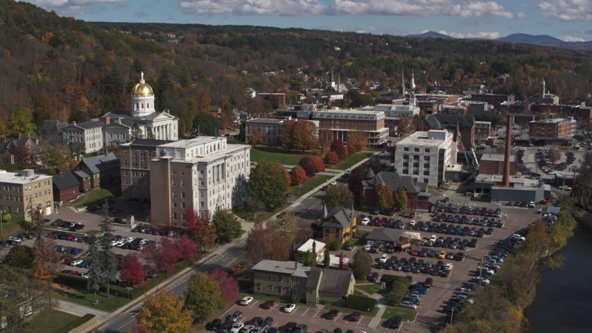 5.7K stock footage aerial video reverse view of government office and state capitol building near the river, Montpelier, Vermont Aerial Stock Footage | DX0002_218_017