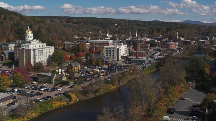 5.7K stock footage aerial video of downtown buildings and smoke stack by the river, Montpelier, Vermont Aerial Stock Footage | DX0002_218_018