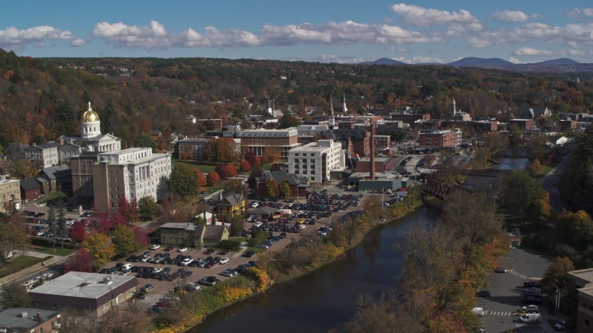 5.7K stock footage aerial video fly away from government offices and smoke stack by capitol and the river, Montpelier, Vermont Aerial Stock Footage | DX0002_218_020