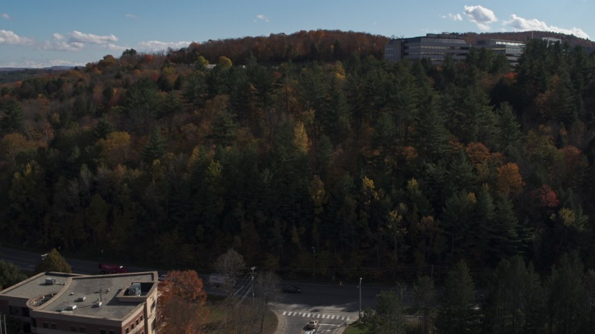 5.7K stock footage aerial video of approaching an office building on a hill, Montpelier, Vermont Aerial Stock Footage | DX0002_218_021