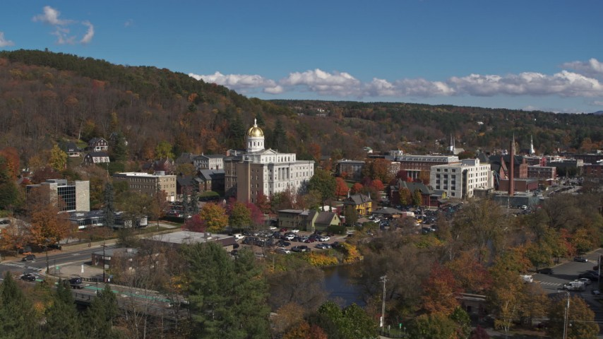 5.7K stock footage aerial video fly over river toward government offices and state capitol building, Montpelier, Vermont Aerial Stock Footage | DX0002_218_023