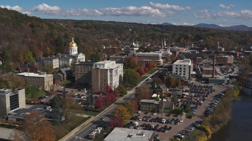 5.7K stock footage aerial video orbit government office building and state capitol, fly away from downtown, Montpelier, Vermont Aerial Stock Footage | DX0002_218_025