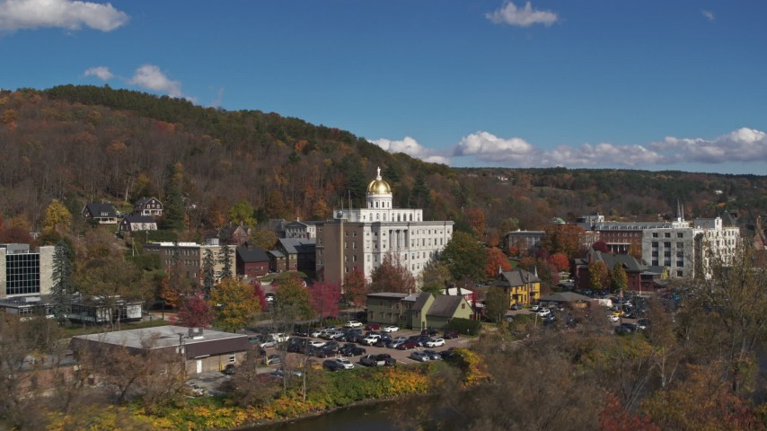 5.7K stock footage aerial video focus on government office building, seen from the river, Montpelier, Vermont Aerial Stock Footage | DX0002_218_026