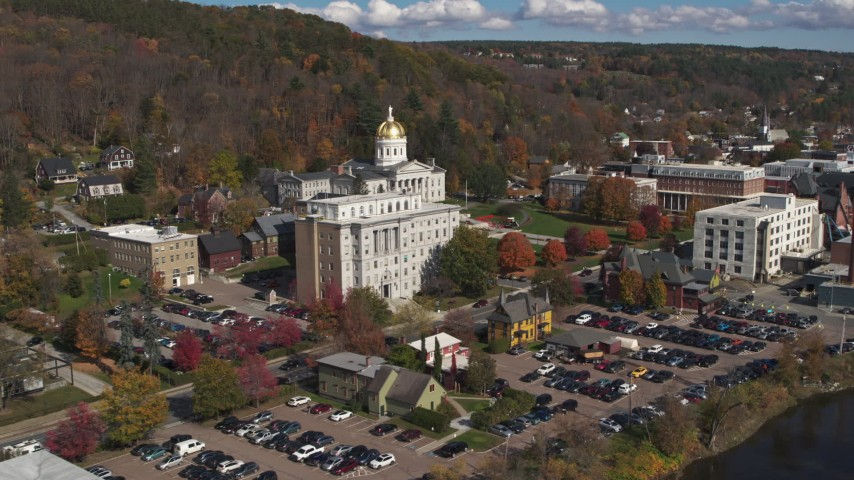 5.7K stock footage aerial video focus on government office building and capitol, descend by the river, Montpelier, Vermont Aerial Stock Footage | DX0002_218_027