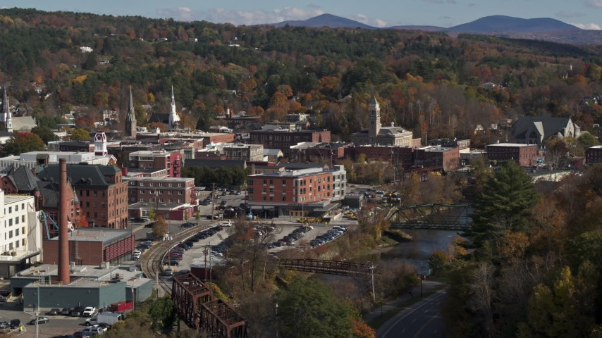5.7K stock footage aerial video of flying by office buildings by the river, Montpelier, Vermont Aerial Stock Footage | DX0002_218_028