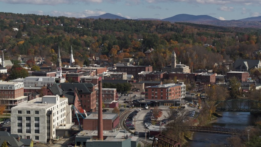 5.7K stock footage aerial video of passing by office buildings by the river, Montpelier, Vermont Aerial Stock Footage | DX0002_218_029