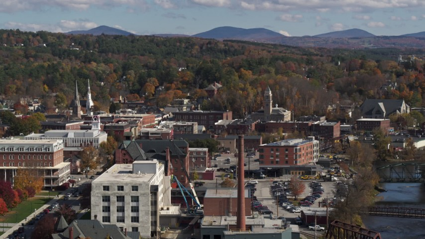 5.7K stock footage aerial video of a smoke stack and city buildings by the river, Montpelier, Vermont Aerial Stock Footage | DX0002_218_030