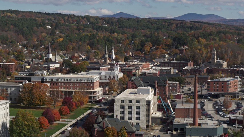 5.7K stock footage aerial video of steeples seen from a smoke stack and city buildings, Montpelier, Vermont Aerial Stock Footage | DX0002_218_031