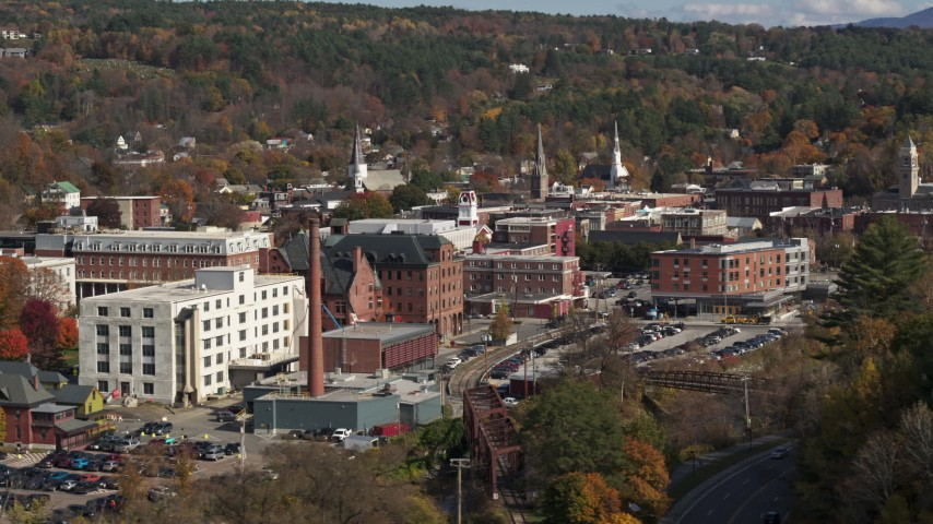 5.7K stock footage aerial video of flying by office buildings by a smoke stack, Montpelier, Vermont Aerial Stock Footage | DX0002_218_032