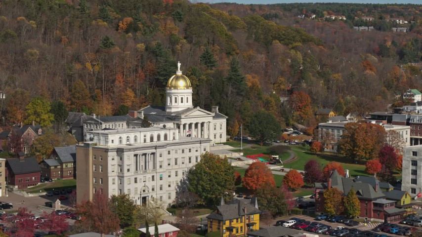 5.7K stock footage aerial video of the state capitol behind a government office building, Montpelier, Vermont Aerial Stock Footage | DX0002_218_035