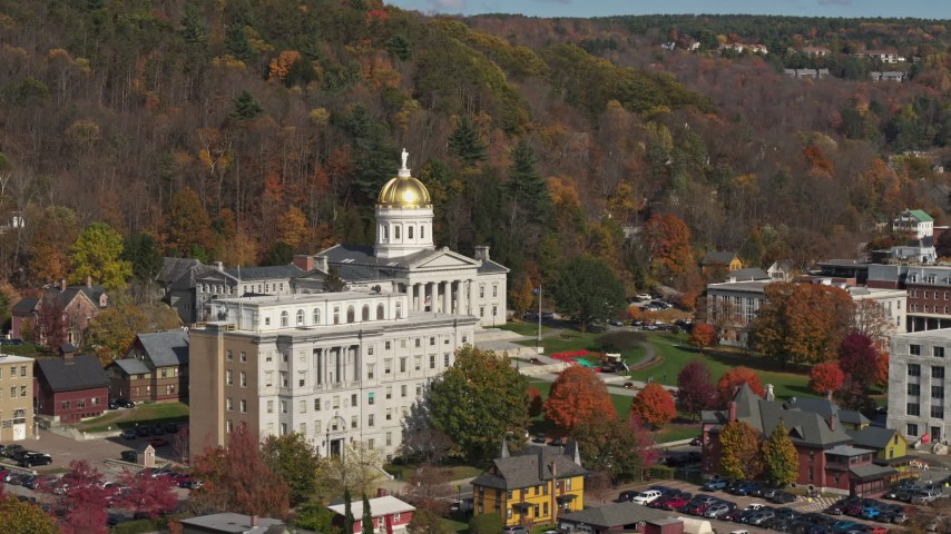 5.7K stock footage aerial video of approaching the state capitol behind a government office building, Montpelier, Vermont Aerial Stock Footage | DX0002_218_036