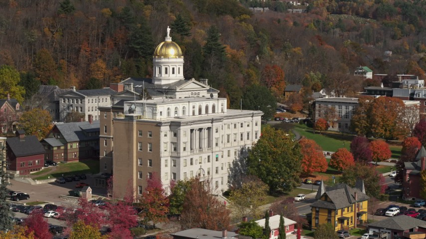 5.7K stock footage aerial video descend by a government office building, capitol dome behind it, Montpelier, Vermont Aerial Stock Footage | DX0002_218_039