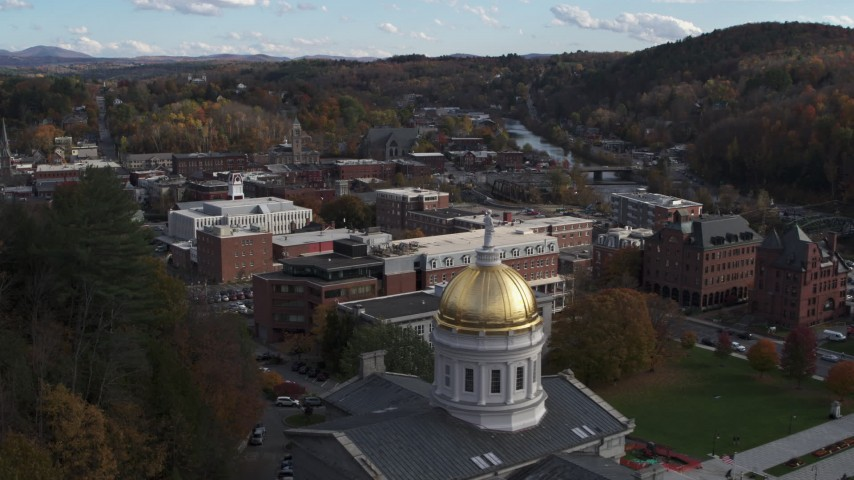 5.7K stock footage aerial video fly away from brick buildings to reveal the Vermont State House in Montpelier Aerial Stock Footage | DX0002_219_008