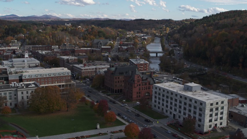 5.7K stock footage aerial video descend with view of government and brick office buildings near the river in Montpelier, Vermont Aerial Stock Footage | DX0002_219_013