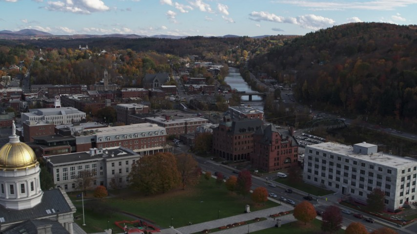 5.7K stock footage aerial video ascend with view of government and brick buildings near the river, reveal capitol, Montpelier, Vermont Aerial Stock Footage | DX0002_219_014