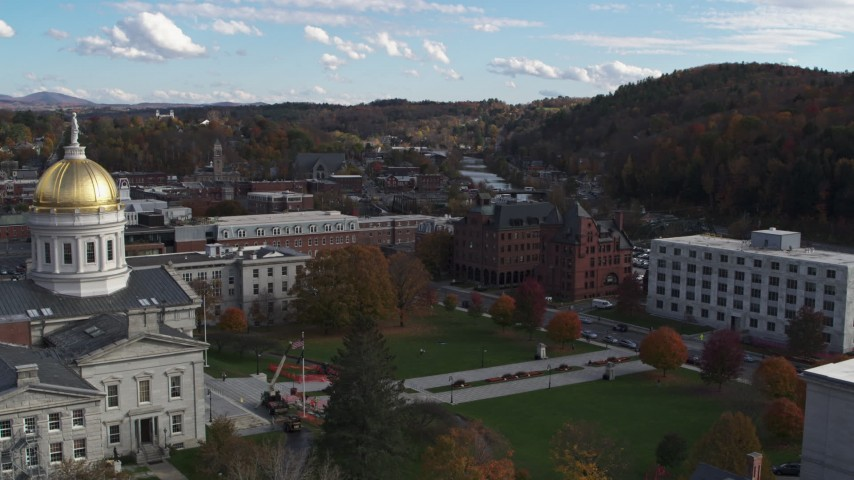5.7K stock footage aerial video a view of government and brick buildings near the river while descending by the capitol, Montpelier, Vermont Aerial Stock Footage | DX0002_219_016