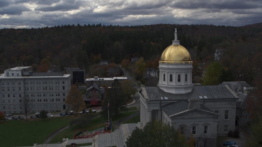 5.7K stock footage aerial video reverse view of the golden dome and front steps of the capitol building, Montpelier, Vermont Aerial Stock Footage | DX0002_219_023