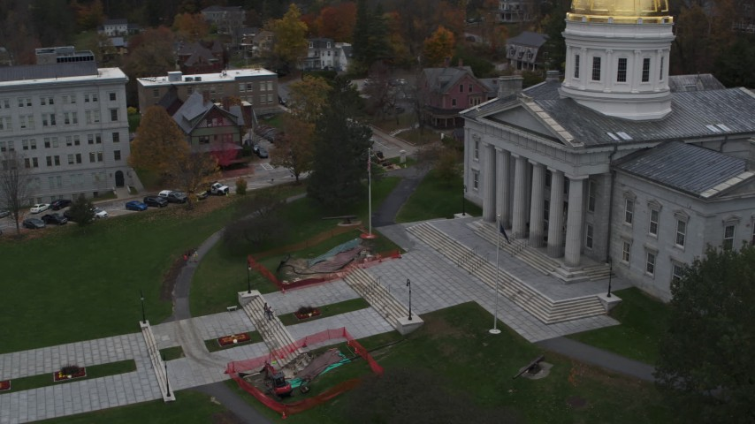 5.7K stock footage aerial video orbiting people walking up the front steps of the capitol building, Montpelier, Vermont Aerial Stock Footage | DX0002_219_027