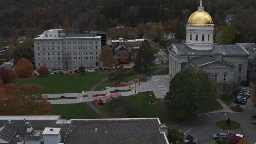 5.7K stock footage aerial video of flying away from people walking up the front steps of the capitol building, Montpelier, Vermont Aerial Stock Footage | DX0002_219_028