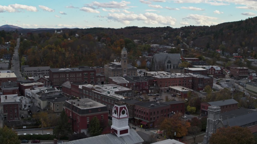 5.7K stock footage aerial video of a wide orbit of city hall and downtown buildings before descent, Montpelier, Vermont Aerial Stock Footage | DX0002_219_033