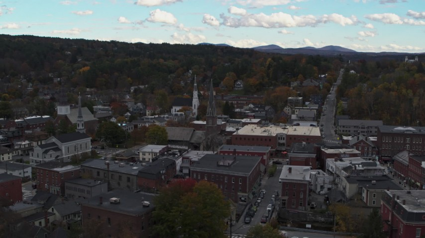 5.7K stock footage aerial video orbit and fly away from church steeple and downtown buildings, Montpelier, Vermont Aerial Stock Footage | DX0002_219_034