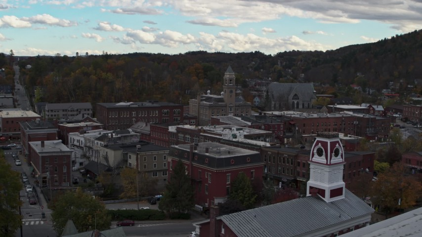 5.7K stock footage aerial video reveal and focus on Asiana House in downtown, Montpelier, Vermont Aerial Stock Footage | DX0002_219_041