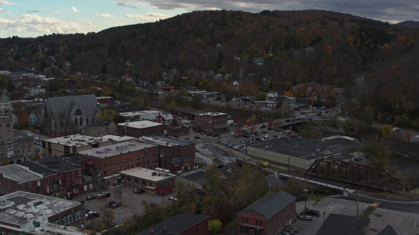 5.7K stock footage aerial video of orbiting buildings by the river in downtown, Montpelier, Vermont Aerial Stock Footage | DX0002_219_047