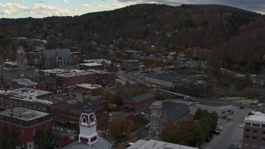 5.7K stock footage aerial video of flying by city hall and buildings by the river in downtown, Montpelier, Vermont Aerial Stock Footage | DX0002_219_048