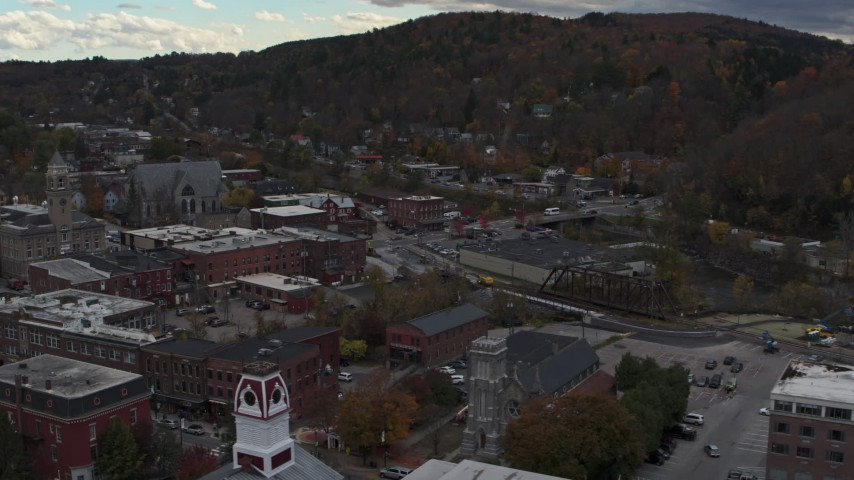 5.7K stock footage aerial video of flying by buildings by the river and city hall in downtown, Montpelier, Vermont Aerial Stock Footage | DX0002_219_049