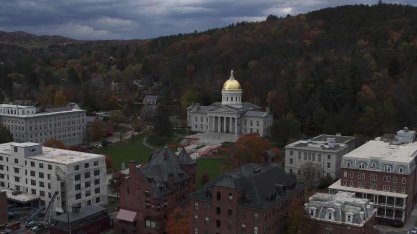 5.7K stock footage aerial video of flying away from the capitol building and buildings around the grounds, Montpelier, Vermont Aerial Stock Footage | DX0002_219_051