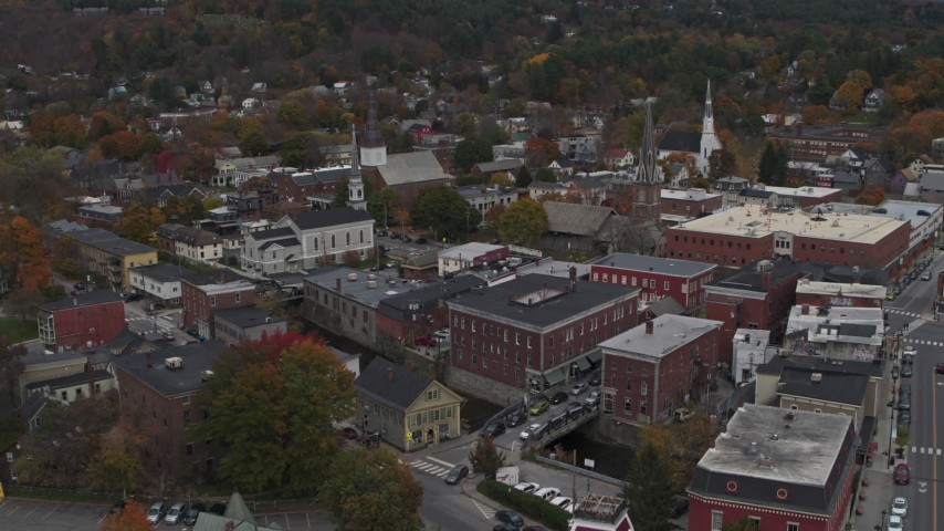 5.7K stock footage aerial video of orbiting and flying away from brick buildings and churches in downtown, Montpelier, Vermont Aerial Stock Footage | DX0002_219_062