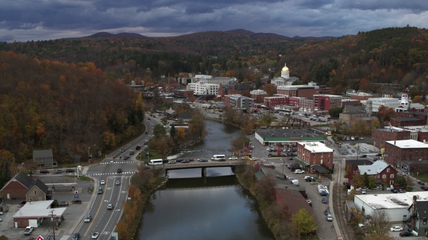 5.7K stock footage aerial video follow the Winooski River toward bridge at sunset, Montpelier, Vermont Aerial Stock Footage | DX0002_220_001