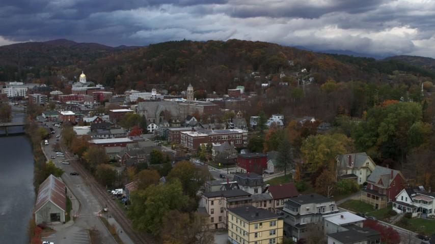 5.7K stock footage aerial video of flying away from city hall at sunset, reveal the river, Montpelier, Vermont Aerial Stock Footage | DX0002_220_006