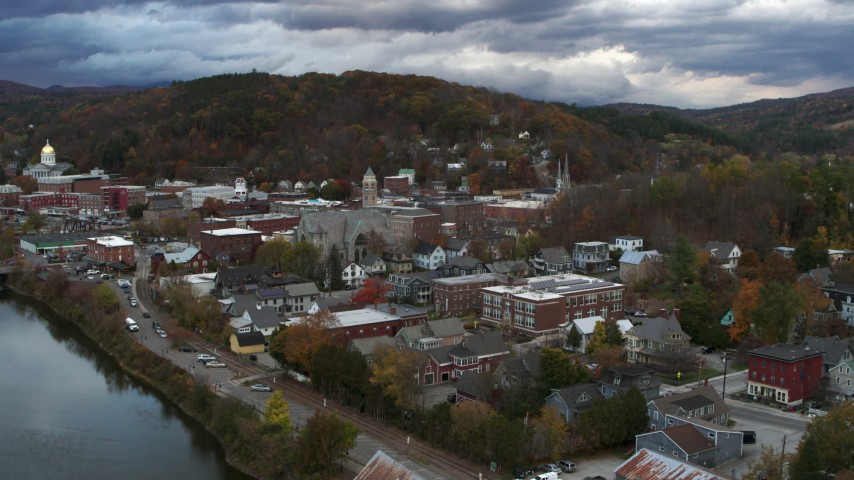 5.7K stock footage aerial video of approaching city hall from the river at sunset, Montpelier, Vermont Aerial Stock Footage | DX0002_220_007