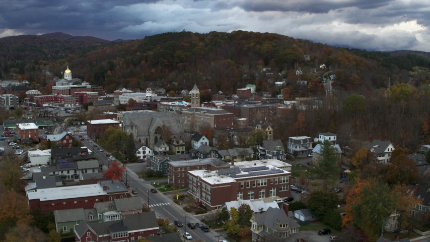 5.7K stock footage aerial video of a reverse view and orbit of city hall and brick buildings at sunset, Montpelier, Vermont Aerial Stock Footage   DX0002_220_009
