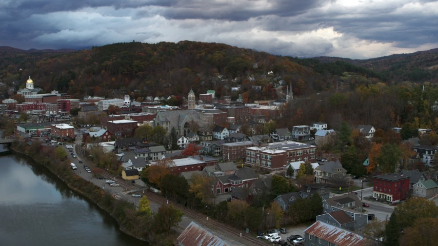 5.7K stock footage aerial video of a wide orbit of city hall and brick buildings at sunset, Montpelier, Vermont Aerial Stock Footage | DX0002_220_010